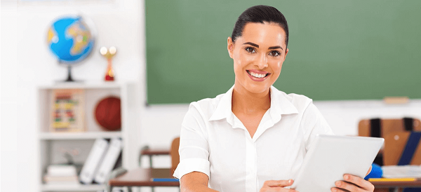 Student loan forgiveness for teachers illustrated by sitting female teacher