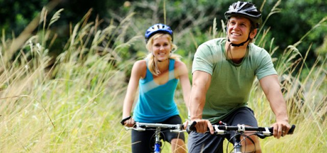 Couple Cycling in Suburbs