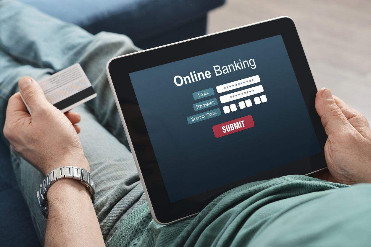 a person using tablet for online banking.